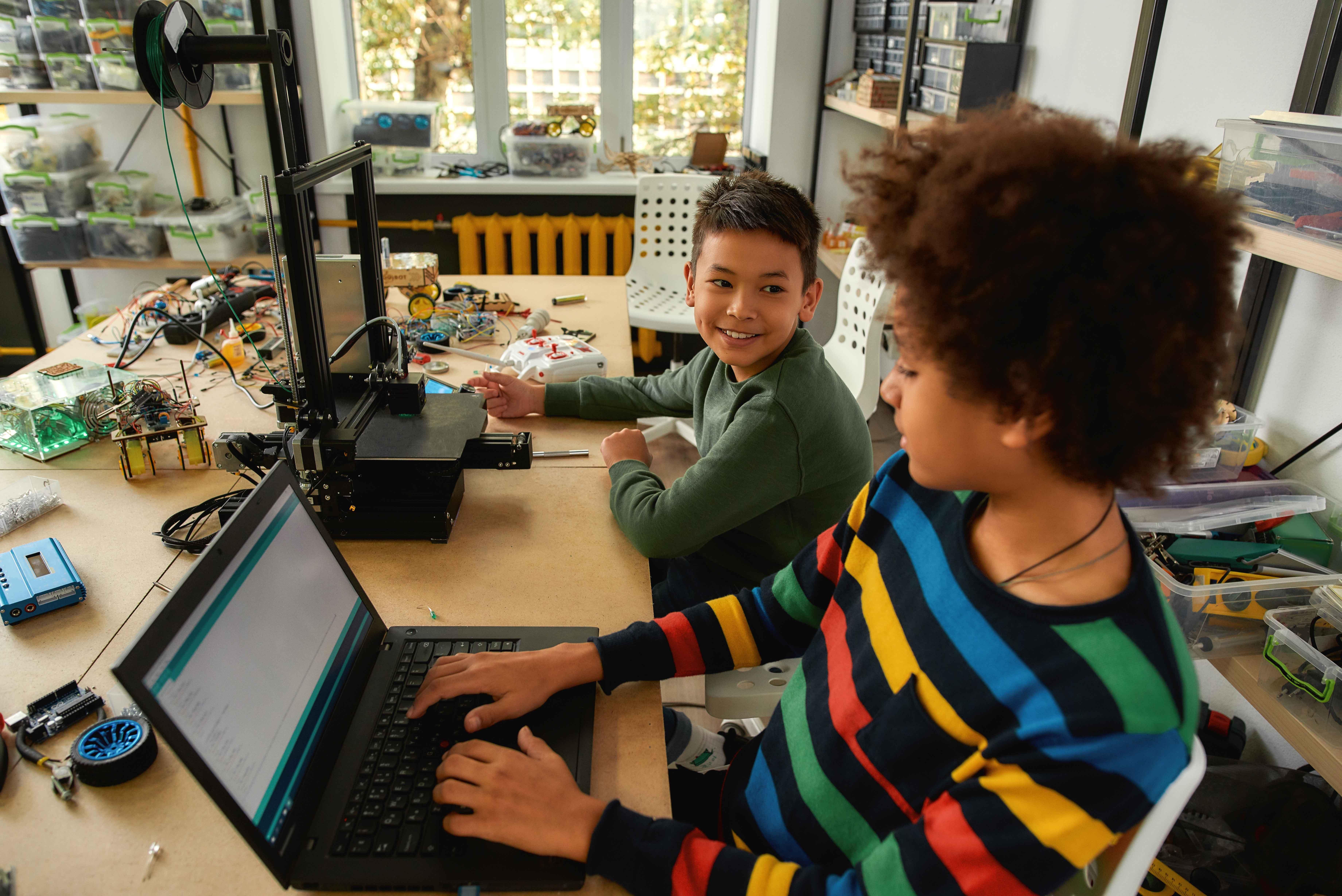 STEM students using laptop in school