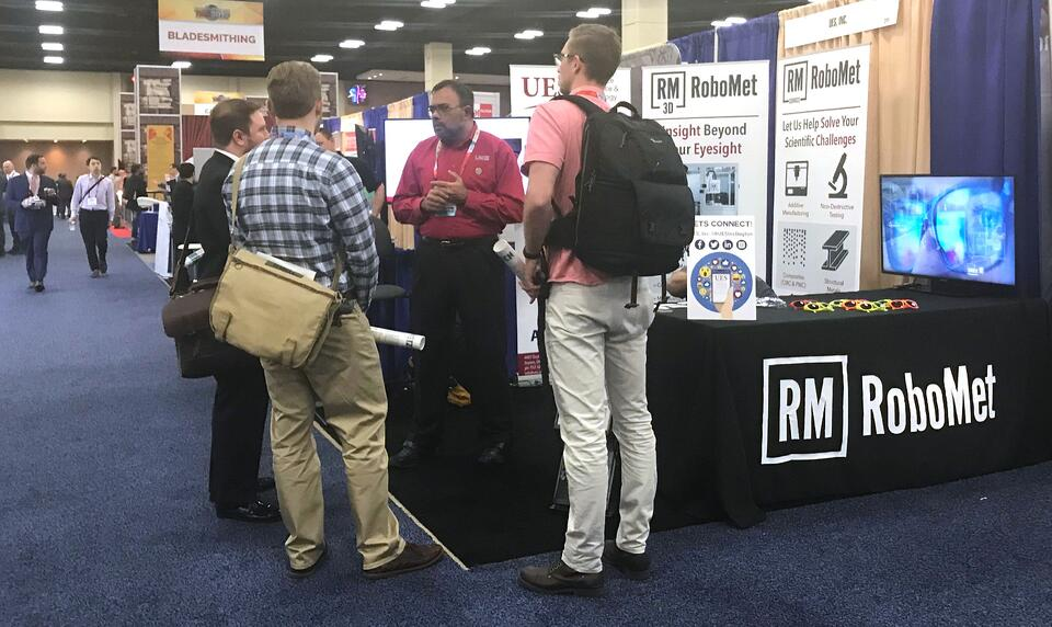 Dr. Sundar discussing materials insights uncovered through Robo-Met serial sectioning with materials researchers at TMS 2019
